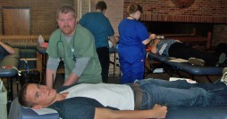 Donor Care Specialist Donald Marsh preps senior Josiah Ringelberg for donating blood. Photo by Connor Sterchi