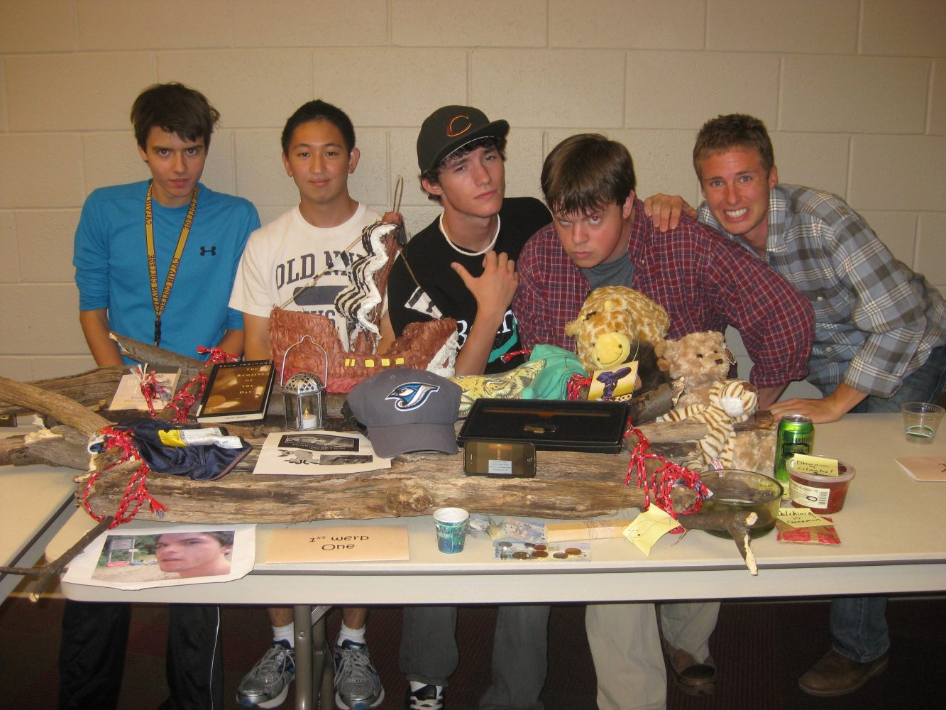 Photo Caption (Left to Right): First-place winners Will Noyes, Manebu Taketani, Baxter, Atticus Getz, and Tom Bouwkamp pose with their display. Photo by Kate Parsons