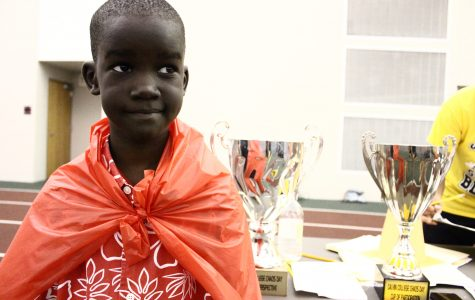 Sudanese refugees cheer on dorms at Chaos Day