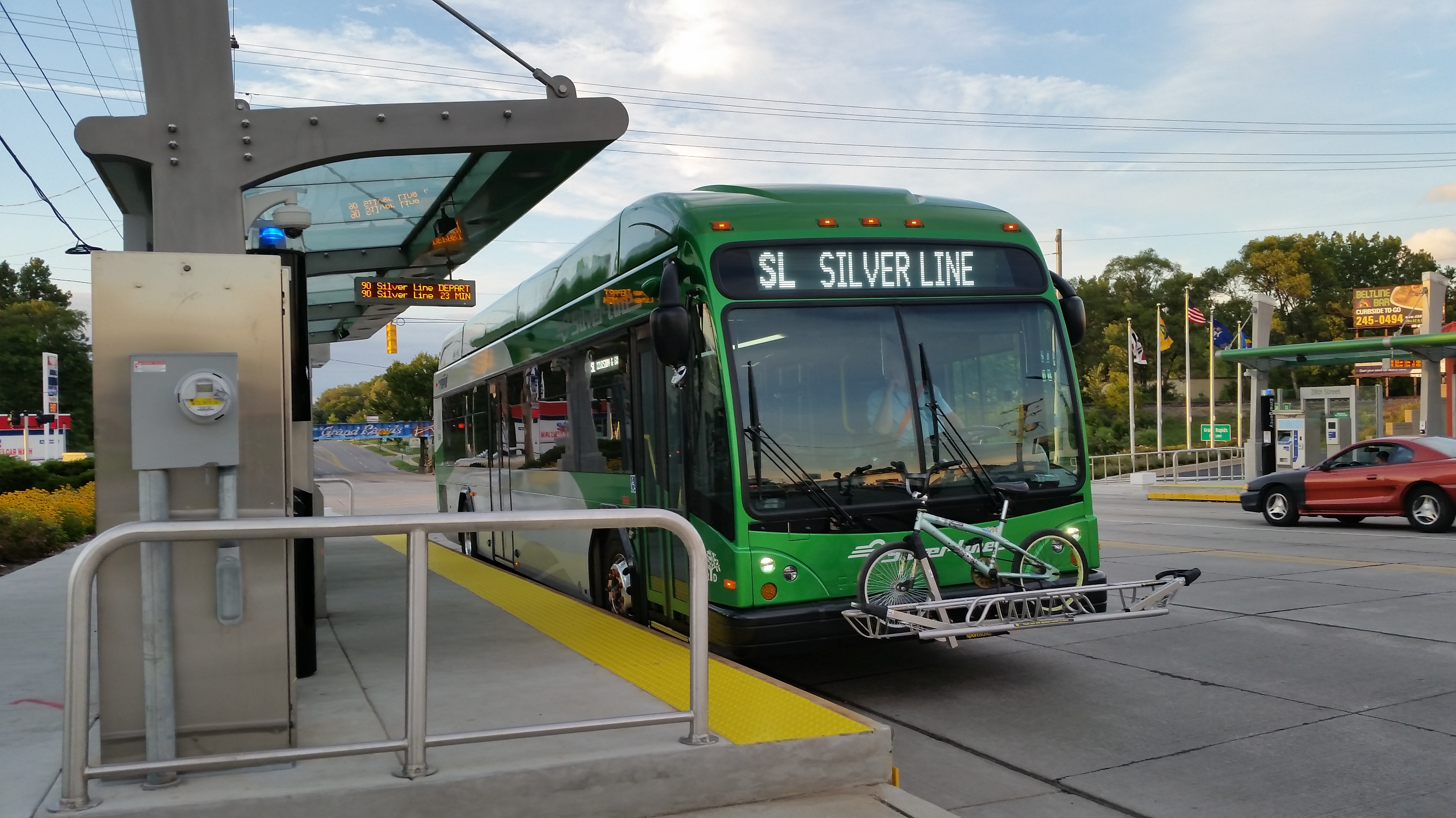 The Silver Line departing from a station.