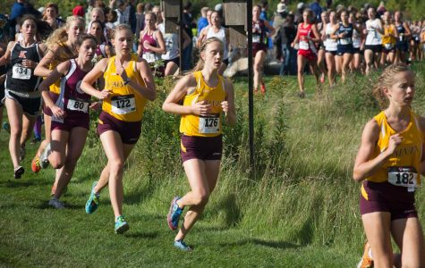 Men and Women's Cross Country Finish First