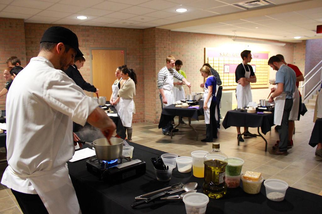 Ramirez leads a cooking class for Calvin upperclassmen. Photo courtesy calvin.edu