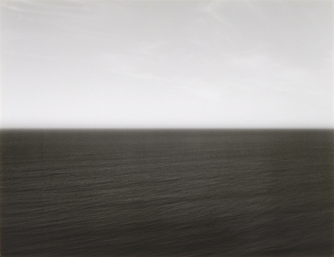 This photograph belongs to Hiroshi Sugimotos famed Seascapes series (1980 - present). Sugimoto began this body of work by photographing views of the worlds various oceans and seas, traveling around the world to make pictures that, despite their vastly different geographic origins, seem at first to be the same, with only slight variations. Their captions confirm that each is of a different body of water: Atlantic, Caribbean, Pacific, Adriatic. Photo Courtesy Joel Zwart