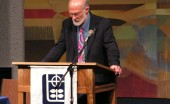 Stanley Hauerwas giving a lecture at Luther College. Photo courtesy Flickr user Jordon Cooper