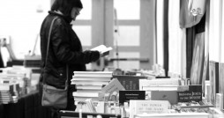 A participant browsing the books at the Festival of Faith and Writing in 2014, Photo courtesy Festival of Faith and Writing
