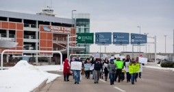 Protesters march in front of Gerald R. Ford International Airport; Photo by Daytona Niles