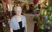 Baronenelle Stutzman stands in her flower shop. Photo courtesy Tri-City Herald.