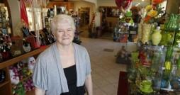 Baronenelle Stutzman stands in her flower shop. Photo courtesy Tri-City Herald.