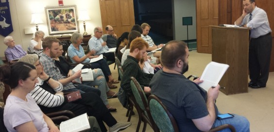 Professor Noe draws on scripture and John Calvin's writing as he leads a study on suffering.  Photo courtesy David Noe.