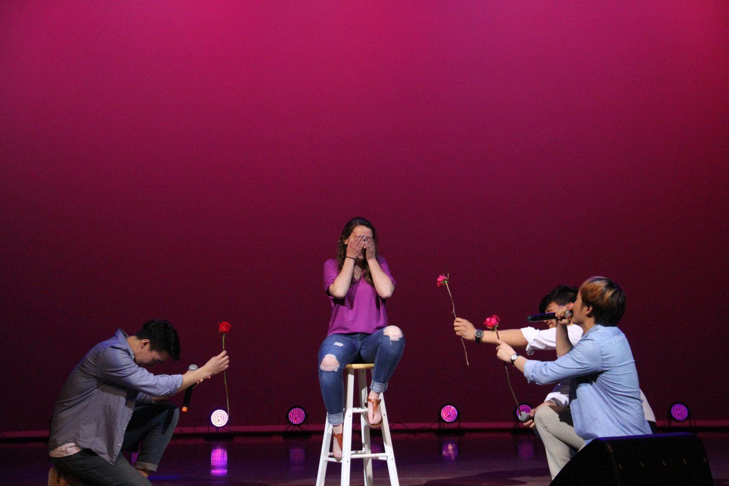 The+singing%2Frapping+group+Naughty+Boys+serenade+a+student+randomly+picked+to+come+on+stage.+Photo+by+Michael+Hsu.