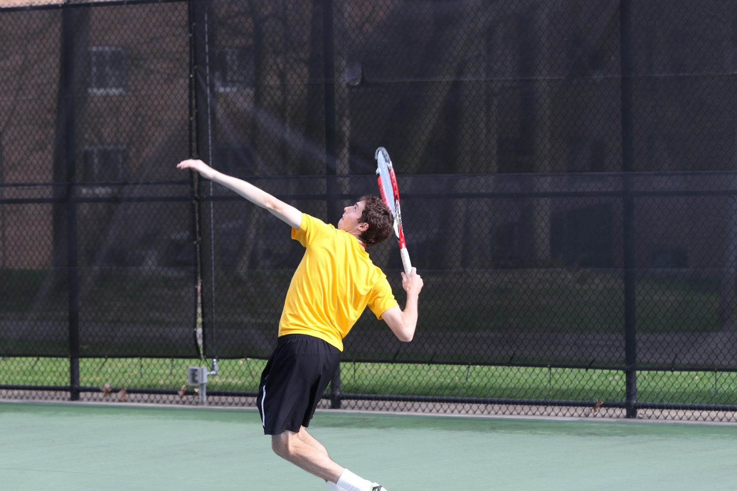 Dave+Brown+serves+up+the+ball+earlier+in+the+season+against+Albion+College.+Photo+courtesy+Calvin+Sports+Information.