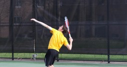 Dave Brown serves up the ball earlier in the season against Albion College. Photo courtesy Calvin Sports Information.