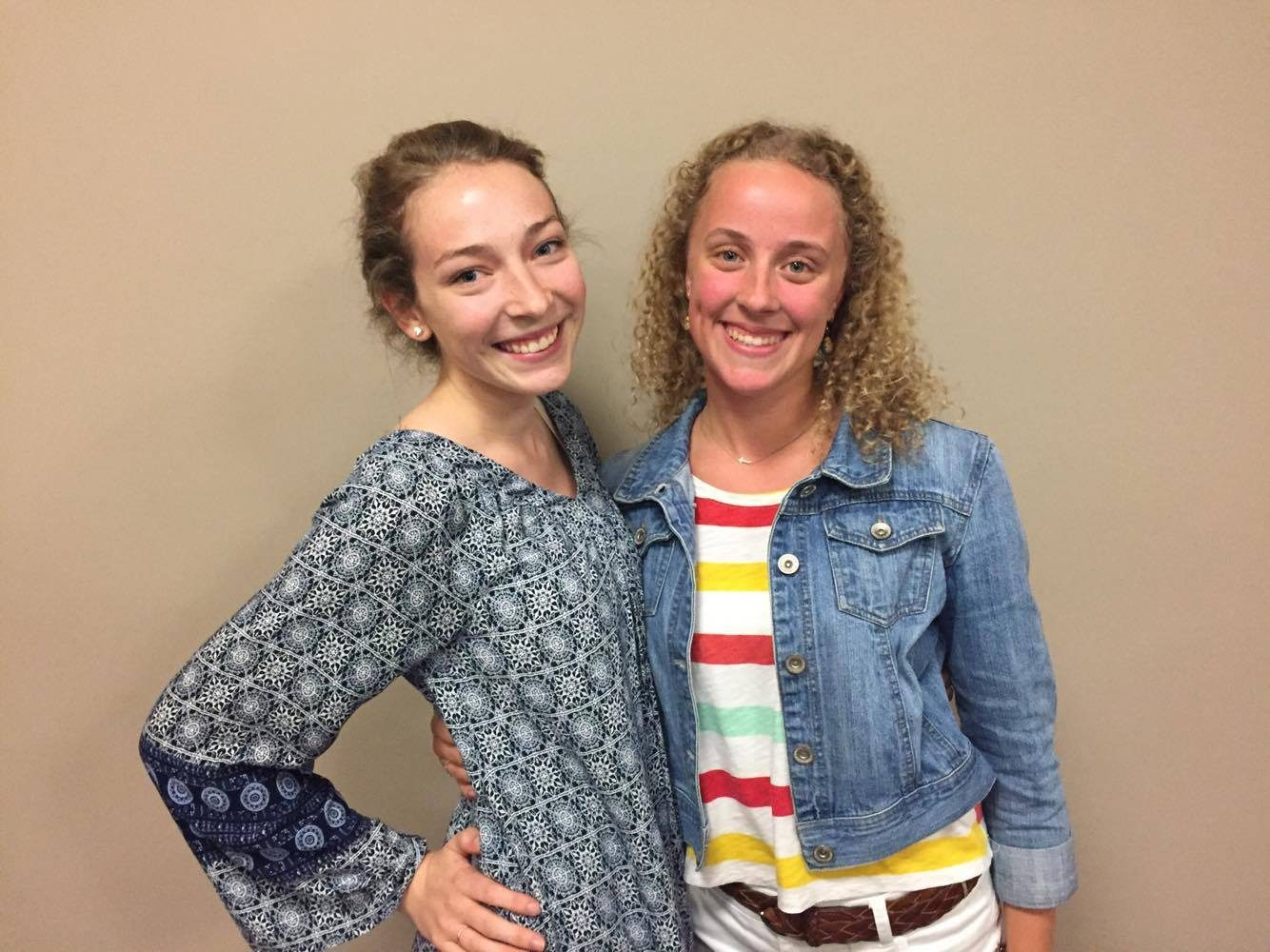 Emily Jo Mulder (left) Sarah Griffioen (right), juniors, are the leaders of Calvin's first women's  a cappella group. Photo by Kendra Walters.