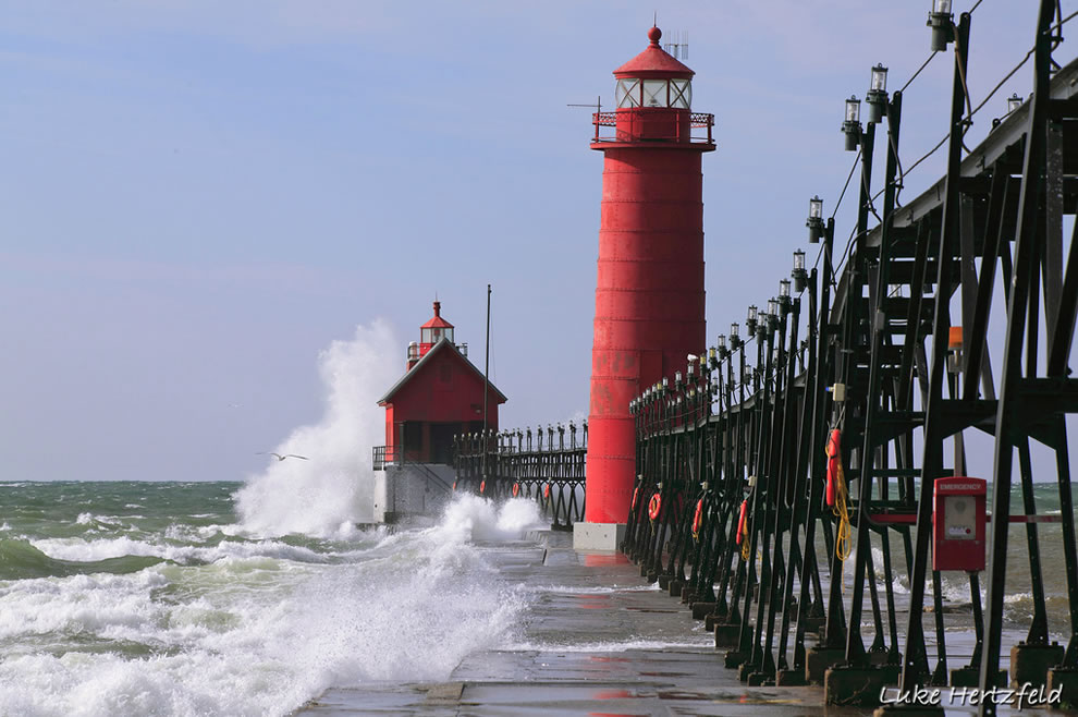 The Grand Haven pier and lighthouse stands firm through Lake Michigan's choppy waters. Photo credit Luke Hertzfeld.