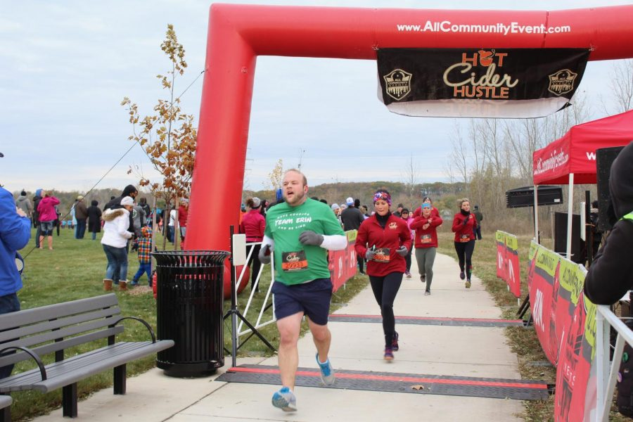 Runners cross the finish line at the Hot Cider Hustle. Photo by Morgan Anderson.