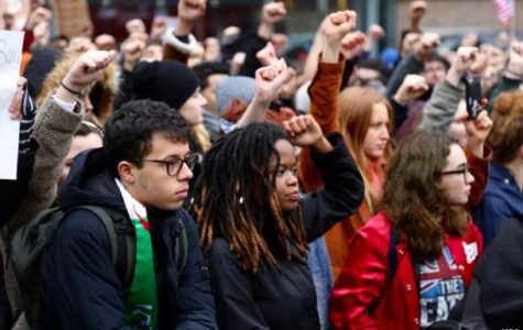 High school protesters conduct walkout, colleges forgive potential suspensions