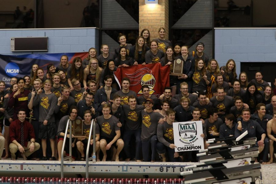 The+men%27s+and+women%27s+swimming+and+diving+teams+celebrate+together+after+their+victories.+Photo+courtesy+Calvin+Sports+Information.