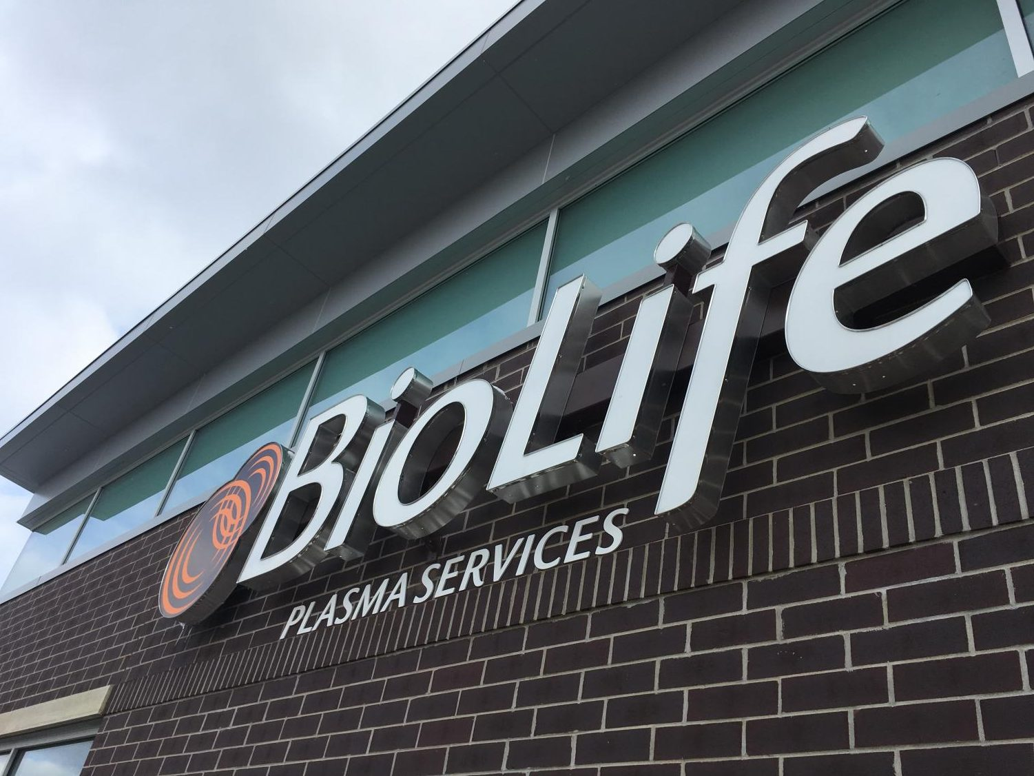 At BioLife, at the corner of East Paris Ave. and Sparks Drive in Grand Rapids, less than a liter of plasma and an hour and a half can earn students $20-50. Photo by David Fitch.