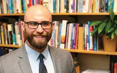 Professor denied tenure by board of trustees
