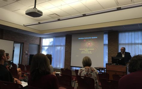 Multiple sclerosis researcher presents to philosophy students