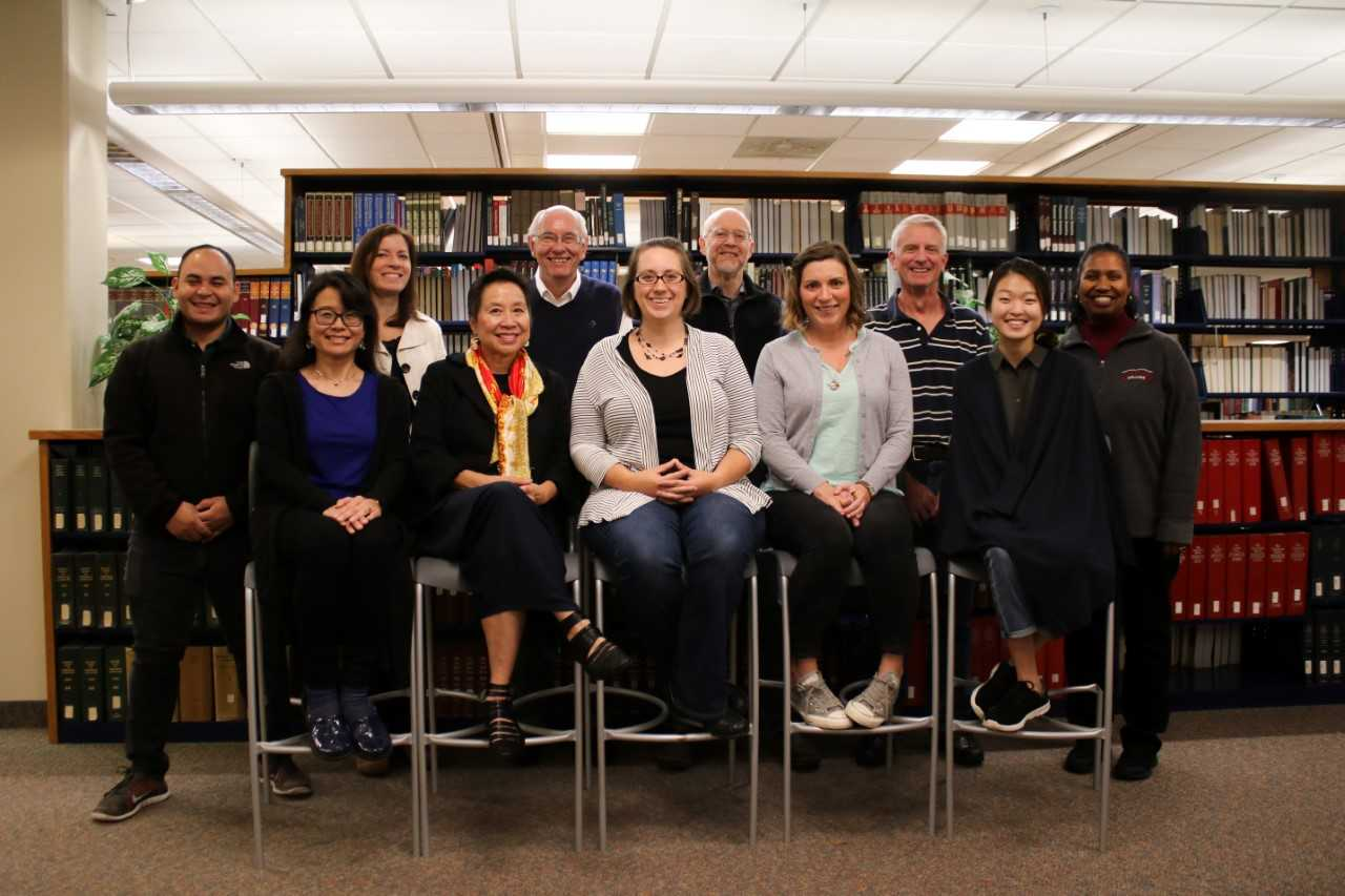 Calvin College Refugee and Immigration Collaborative From back row left: Elvis Garcia Callejas, Amanda Benckhuysen, Ambassador William J. Garvelink, William Katerberg, Tim Baldwin, Michelle Loyd-Paige Front row: Pennylyn Dykstra-Pruim, Anh Vu Sawyer, Stacey Wieland,Sarah Yore-Van Oosterhout, Esq., Ahee Kim Not pictured: Rev. Kate Kooyman and Kate McLain. Photo Courtesy Ahee Kim.