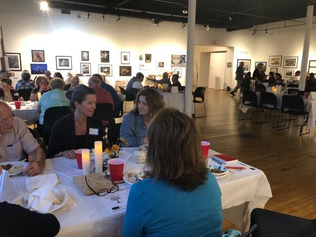 Holland community members discussing faith over Thai food. Credit: Joshua Polanski