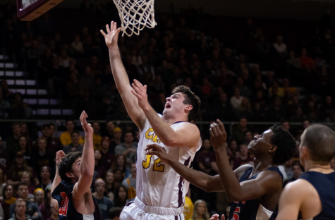Calvin men's basketball holds off Hope in first rivalry game of season