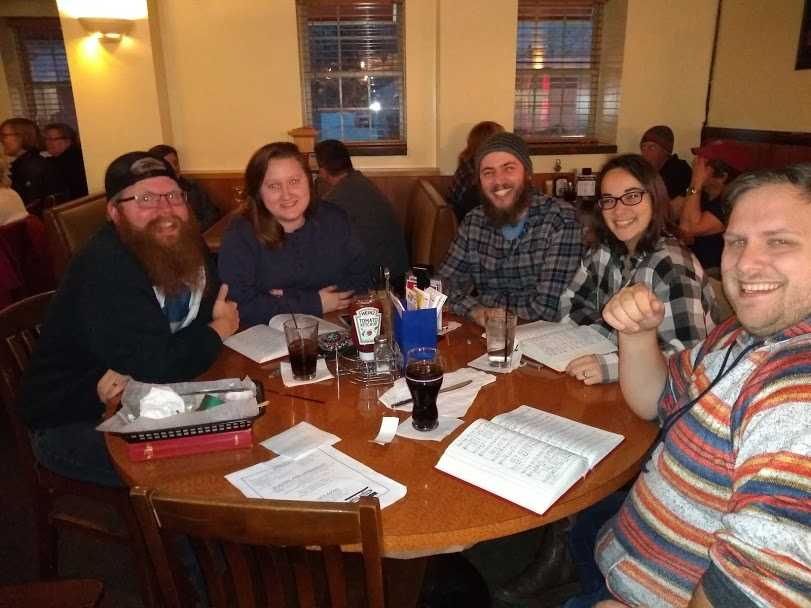 Community members join Beer & Hymns event at Last Chance Tavern.