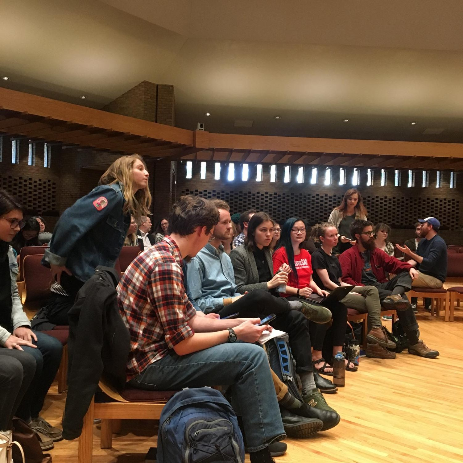 The students from the #SaveSAO group sat in the front row of the Chapel. They raised many of the questions throughout the meeting.