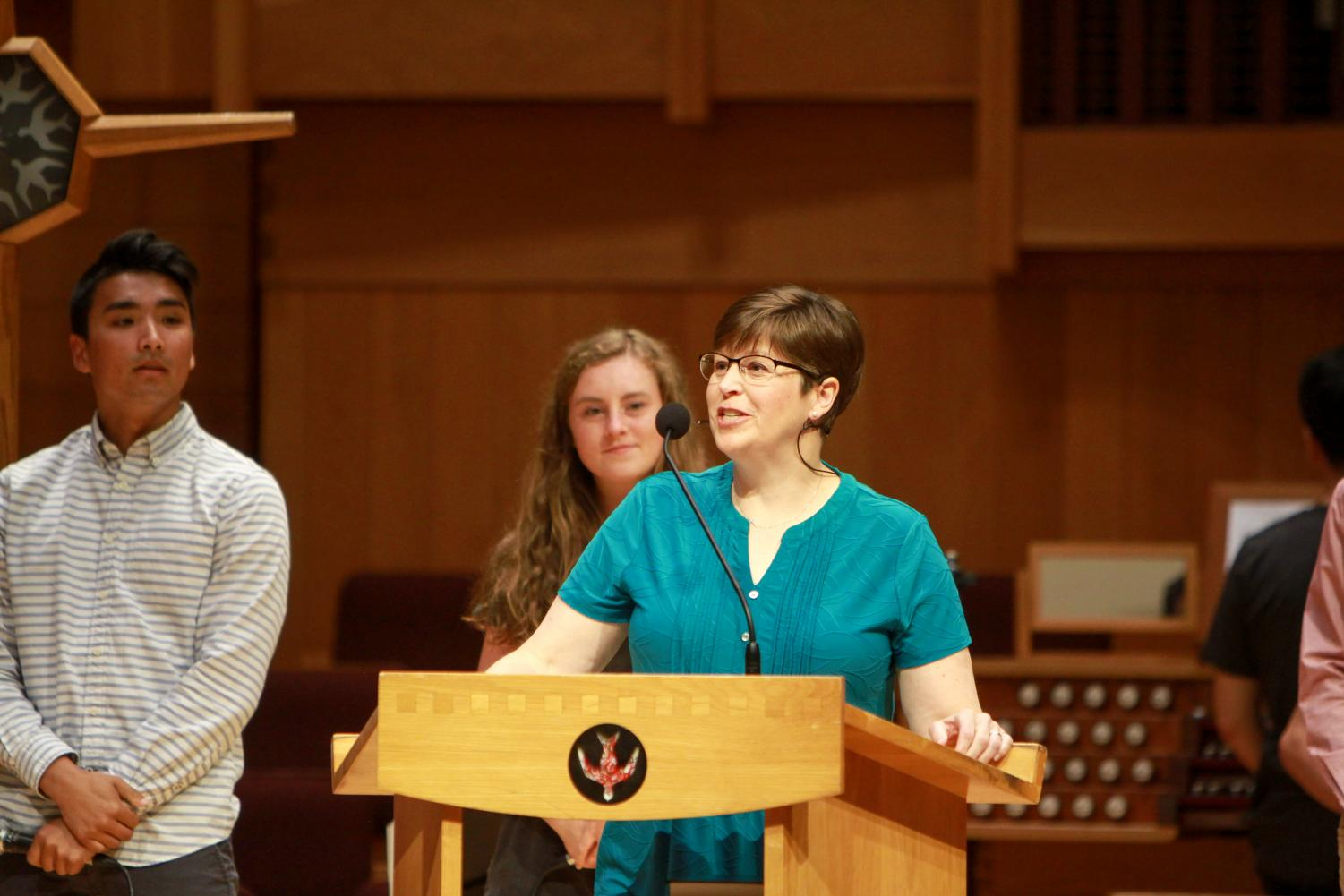 Chaplain+Mary+Hulst+leads+the+audience+in+the+dedication+litany.