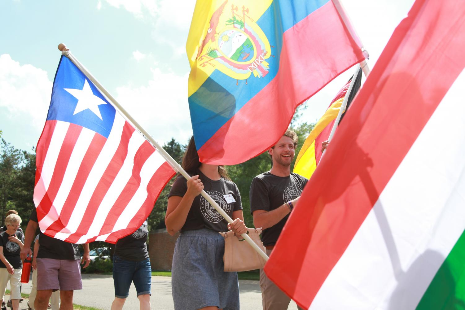 Flag+processional+walks+from+the+chapel+to+the+West+Field+for+the+celebration.