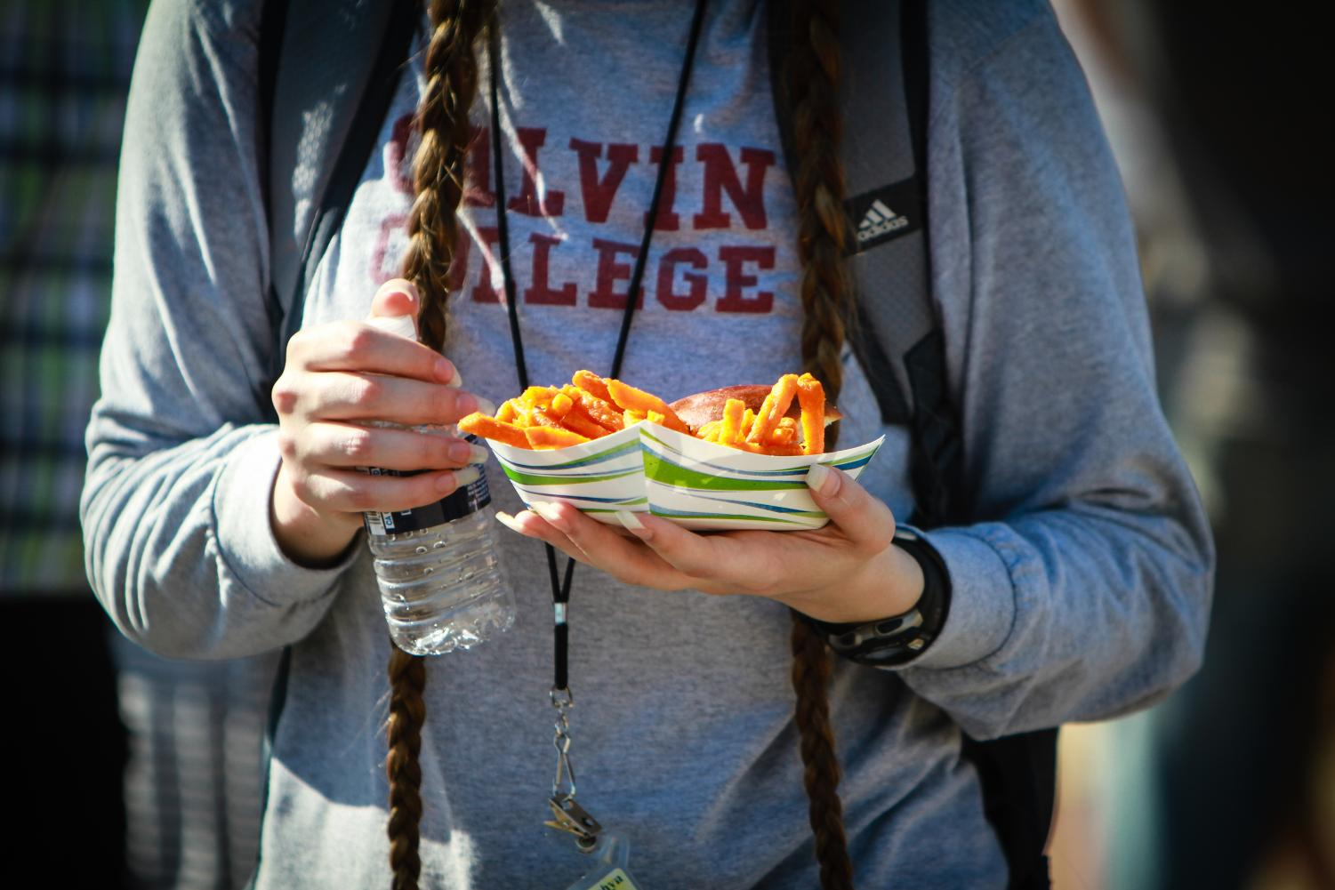 A+guest+snacks+on+one+of+the+food+options+while+sporting+a+vintage+Calvin+College+shirt.