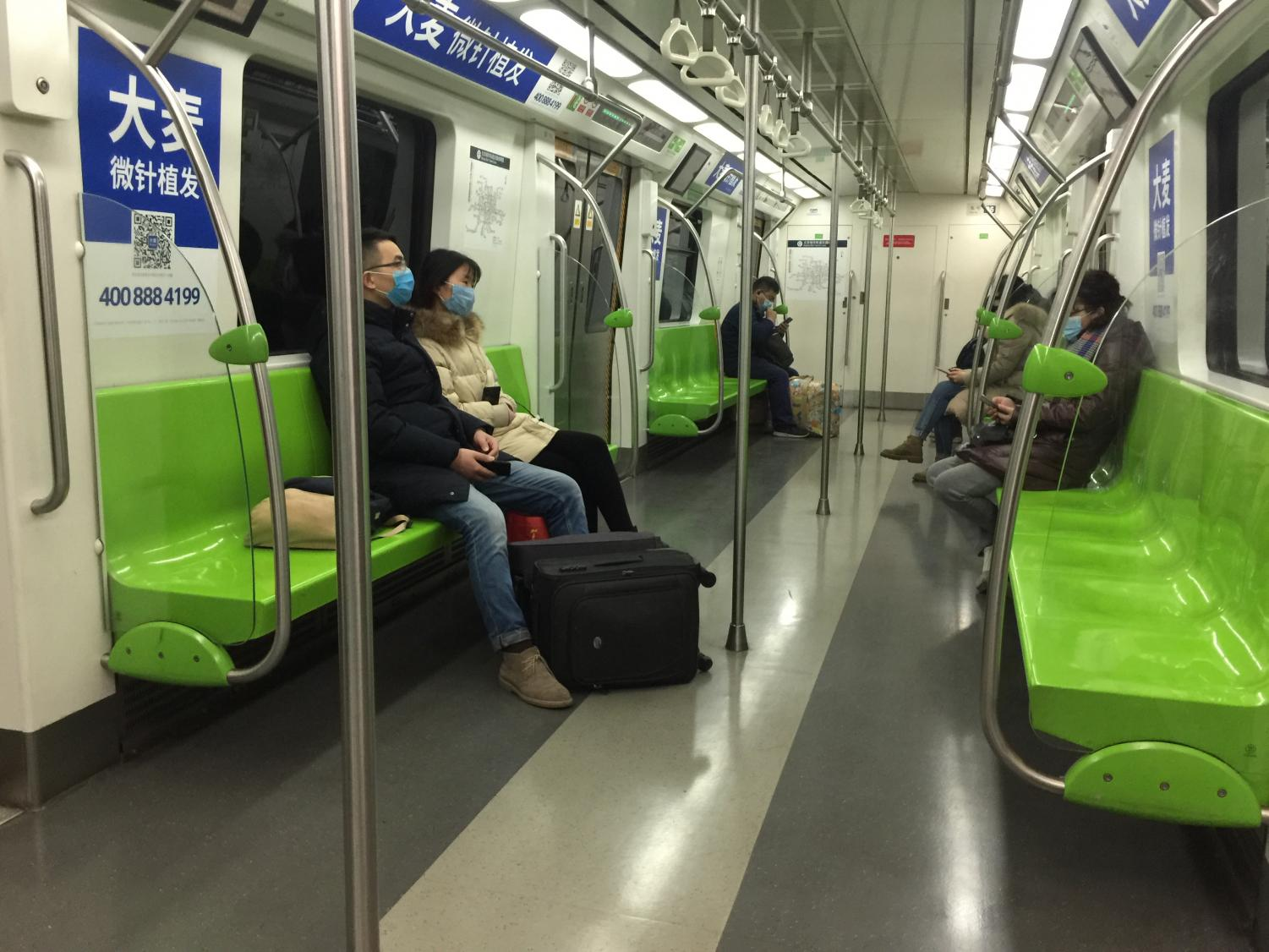 Passengers on an unusually empty subway in Beijing wear masks to protect themselves from the coronavirus.