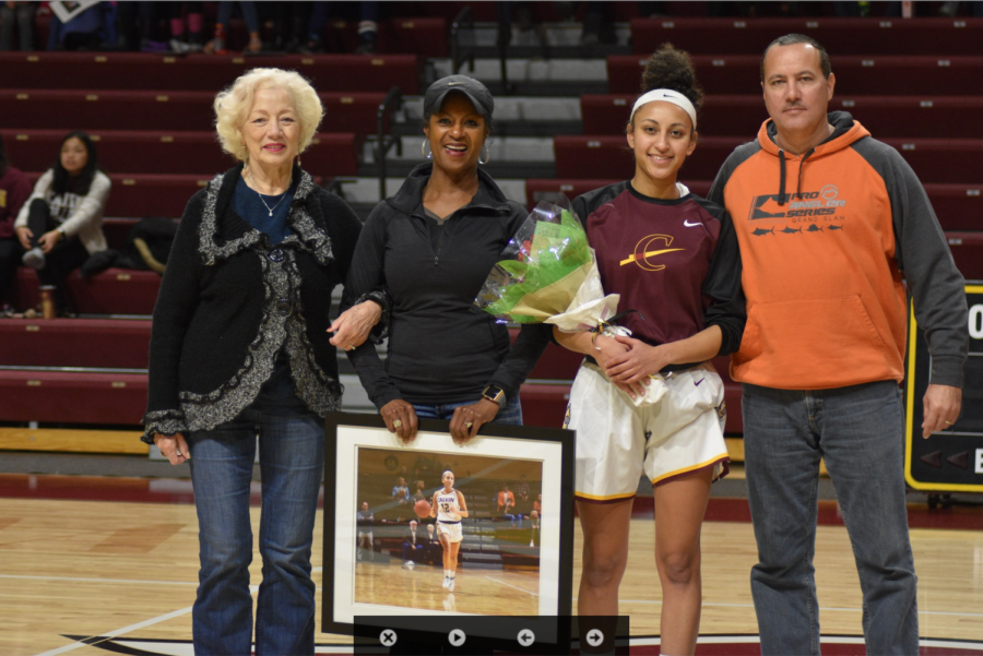 Sydney with her family on senior night