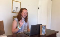 Student teacher Abby Vedders waves hello to her sixth grade class during a Zoom check-in.