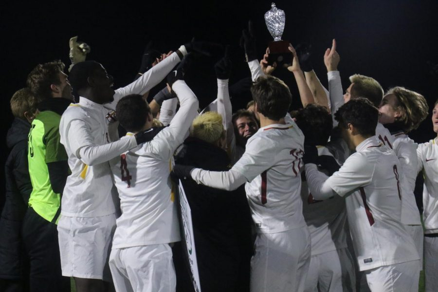 Men's soccer team celebrating their victory over Hope in the MIAA tournament final. (Photo courtesy calvinknights.com)
