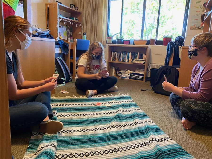 3rd VR residents Gabby Freshly, Stephanie Oosterhouse, and Ellie Jones practice social distancing while playing cards.