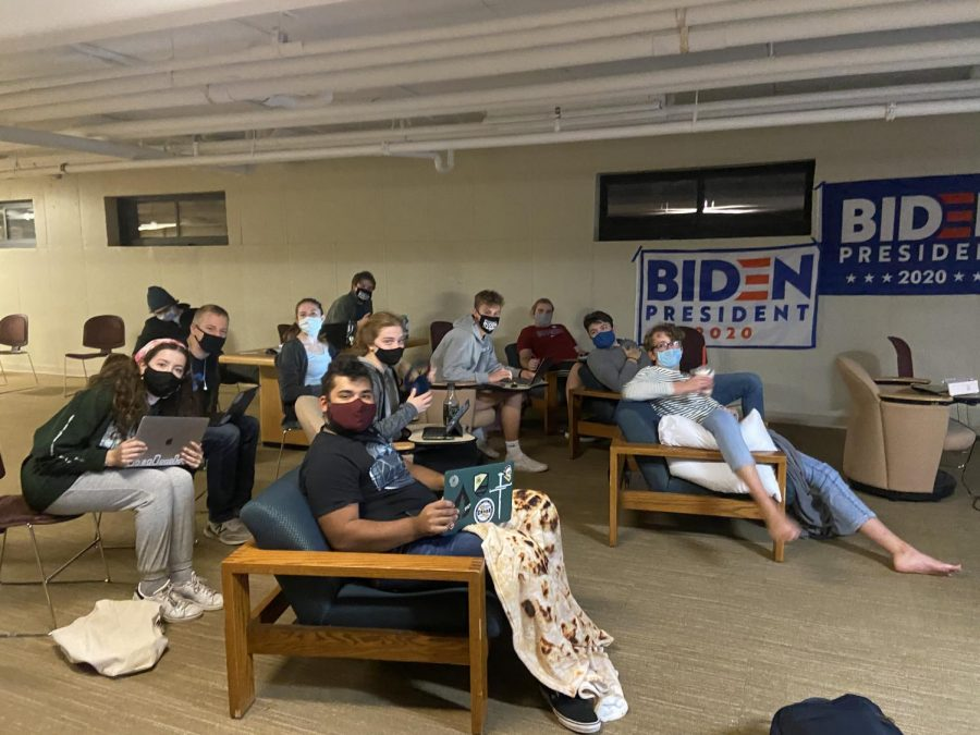 Students in support of Biden gather in the vanReken basement to watch the election night results.