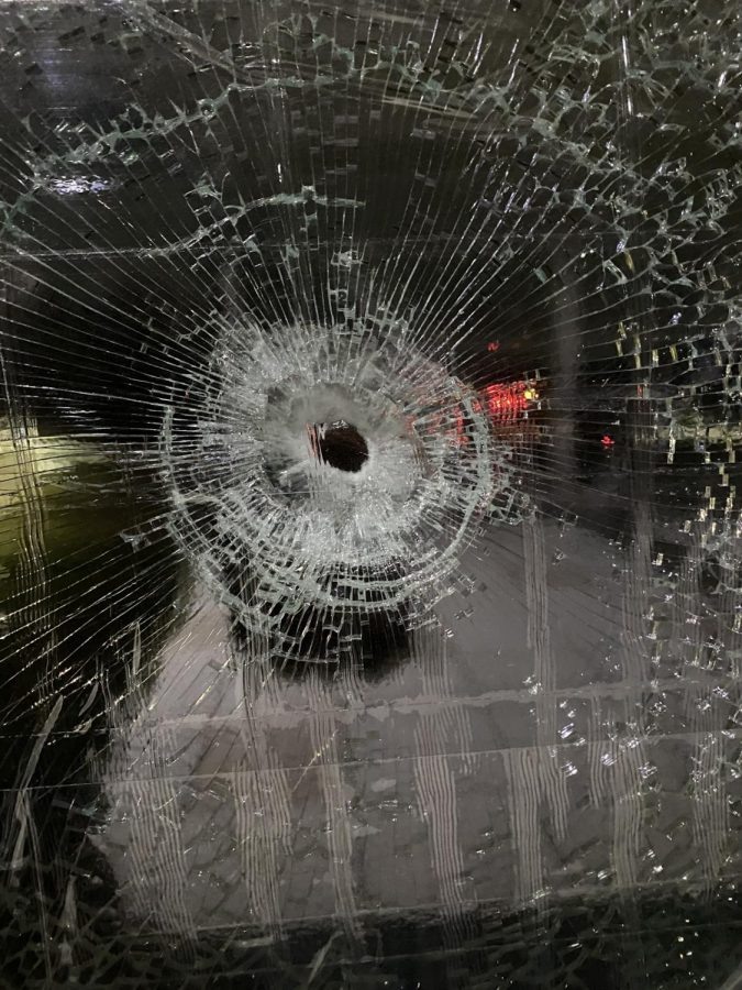 A bullet punctured a panel of glass on the Calvin Crossing.
