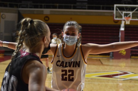 Junior Kamryn Elgersma guards an opponent. Masked play has taken some getting used to for players.