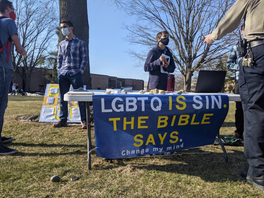 A+student-organized+table+on+Commons+Lawn+spread+anti-LGBTQ+messages+on+Tuesday.+The+university+is+currently+reviewing+whether+or+not+they+followed+the+proper+procedures+to+arrange+their+event.