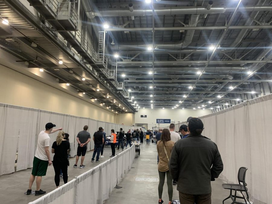 Grand Rapids residents standing in line waiting to be vaccinated at the DeVos convention center downtown.