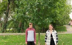 Renee and Toms children, Duncan and Amber, pose next to Toms tree by the seminary pond.